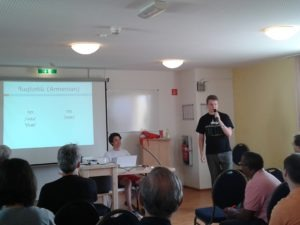 Guy Emerson (left) and Stanislaw Pstrokonski talk about their work developing an online phonetic training tool. (photo (c) the author)