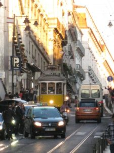 Ding, ding! All aboard....for Portuguese. A grainy dusk in Lisbon (image (c) Howtogetfluent.com)