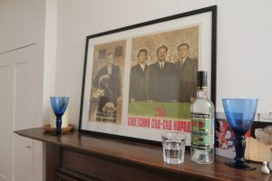 A Soviet propaganda poster and a bottle of vodka