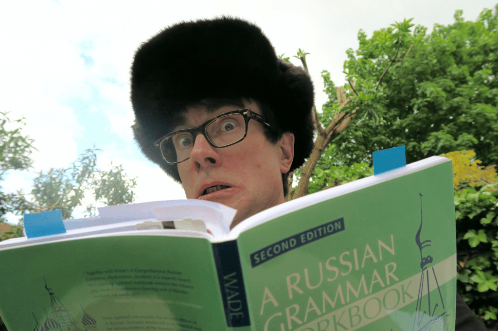 Anxious student looks at Russian grammar book