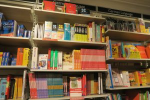 Is German hard to learn? Lots of good materials are available to help (shelf of books for learning German)