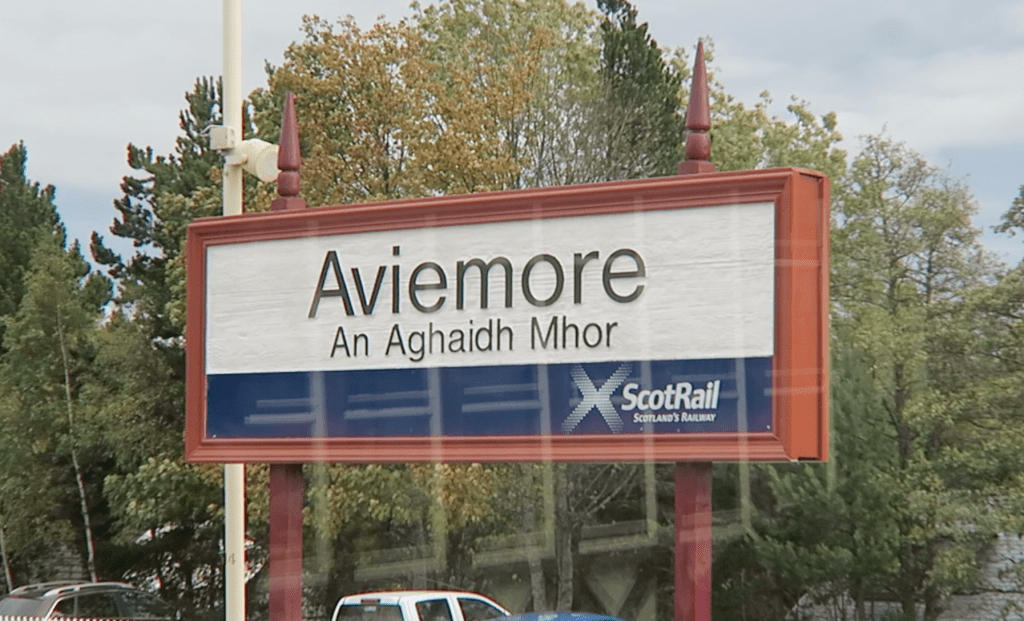 Bilingual place name sign in Scotland Aviemore An Aghaidh Mhor. Learning a minority language can provide a deeper link with the landscape.
