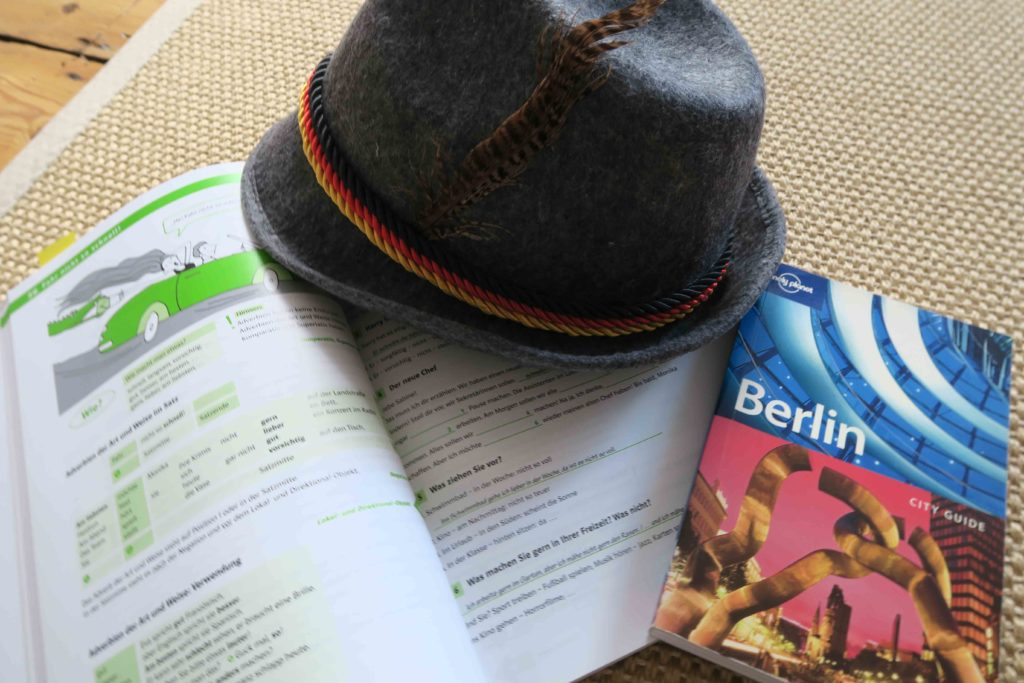 A German hat, German grammar book and a Lonely Planet guide to Berlin.