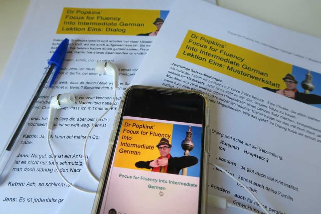 Dr P's Focus for Fluency Into Intermediate German work and info sheets, mobile phone showing the course.