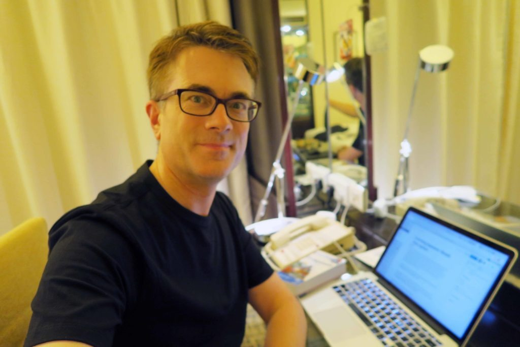 Dr Popkins working on a blog post in a Hong Kong hotel