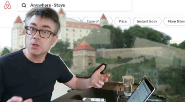 Dr P at his computer talking about how to use AirBnB with Bratislava castle in the background.