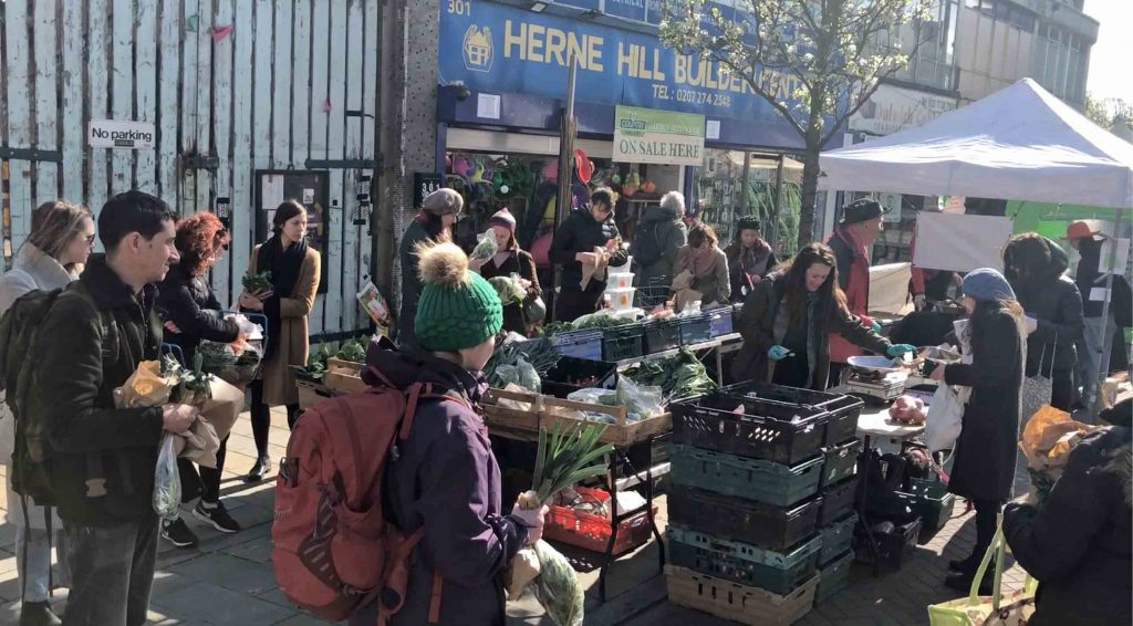 In the crisis, don't visit a market. learn a language at home instead. Herne Hill Farmers Market 22 March 2020
