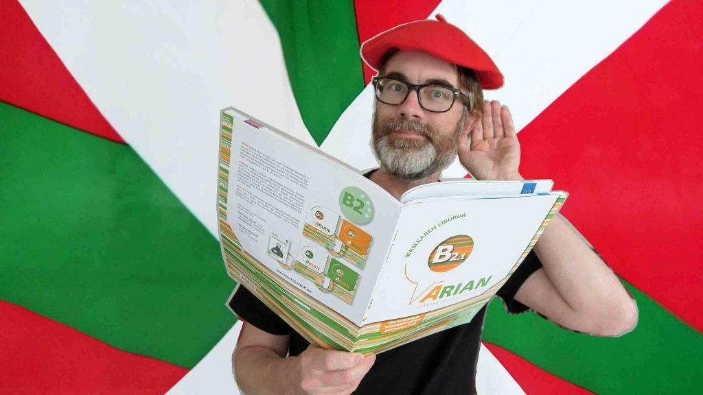Basque flag, red Basque beret learning Basque with Arian B2.1 book.