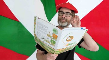 Basque flag, red beret and Basque textbook