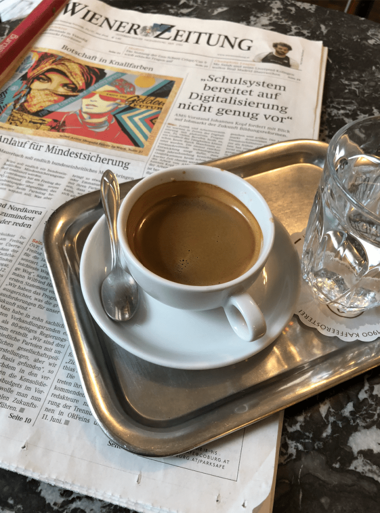 A German newspaper and strong coffee in a cafe in Vienna